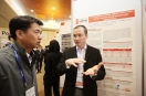 Discussing our research poster at iFAB 2014 in South Korea